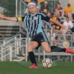 Senior and captain Lauren Sandow attempts to kick the ball in the goal. Photo by Elle Karras