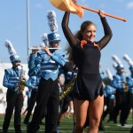 Junior Grace Falley lifts up her flag during the Lancer Dancers' halftime performance. Photo by Aislinn Menke