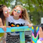 Juniors Katie Reda and Lauren Dierks pose on the Lancer Dancers float for a picture. Photo by Annakate Dilks