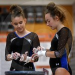 Junior Avery Wilson and freshman Caroline Gorman talk about how the team is performing as they powder their hands. Photo by Megan Stopperan