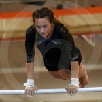 Senior Brooklyn Beck performs her bar routine. Photo by Megan Stopperan