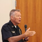 Capt. Mark Schmidt addresses the audience with remarks on school safety procedures and potential improvements. He also spoke on the Shawnee Mission School District's well-known nature amongst other districts as a model to work towards. Photo by Ben Henschel.