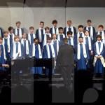 Choir director Ken Foley conducts the Varsity Men's Choir. Photo by Megan Stopperan