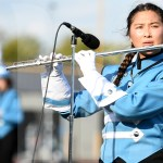 Senior Shelby Winter performs her flute solo during the marching show. Photo by Kate Nixon