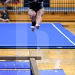 Junior Avery Wilson jumps during her beam routine. Photo by Kate Nixon