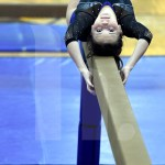 Freshman Jill Rice focuses her beam routine. Photo by Kate Nixon