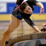Senior Brooklyn Beck competes on the vault. Photo by Kate Nixon