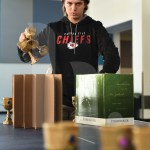 Junior Wylie McCoy sets up Goblet Pong the night before Mol Day. Photo by Sarah Golder