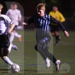 Junior Drew Parisi dribbles past a BVW defender during the beginning of the second half. Photo by Sarah Golder