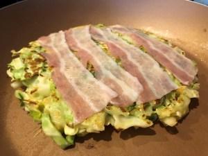 Okonomiyaki Pork Belly laid on Cabbage Patty