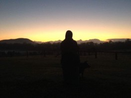 My dog and me sihouetted against the sunrise (Bear as photographer)