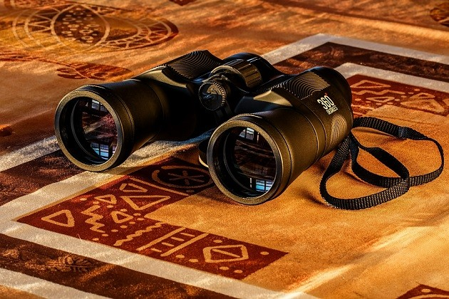 Business website blog - binoculars to depict SEO and online visibility