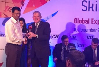 """Mr Arun K Jha, Director General, NIESBUD, receiving an Award for remarkable work in """"Skill Development Sector"""" by Mr. Ian Macfarlane, Ministry of Industry, Govt. of Australia . The 6th Global Summit Skill Development 2014 was organized on 10 November, 2014"""