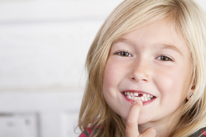 image of child with lost tooth