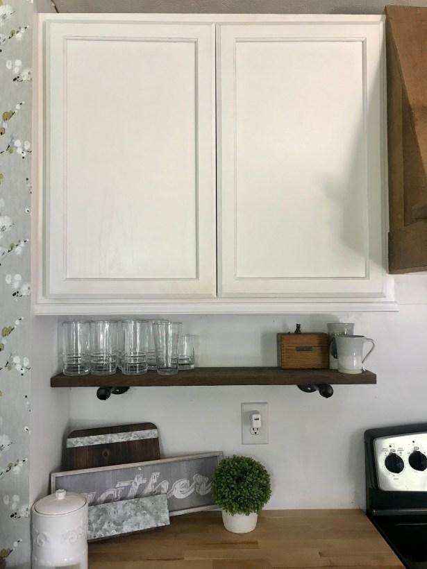 DIY Kitchen Makeover Images illustrates shelf under upper cabinets