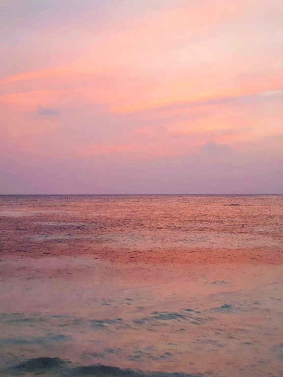 Maldives in 14 sunsets