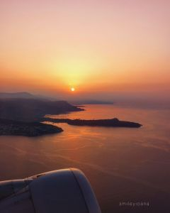 Sunrise above sea from an airplane