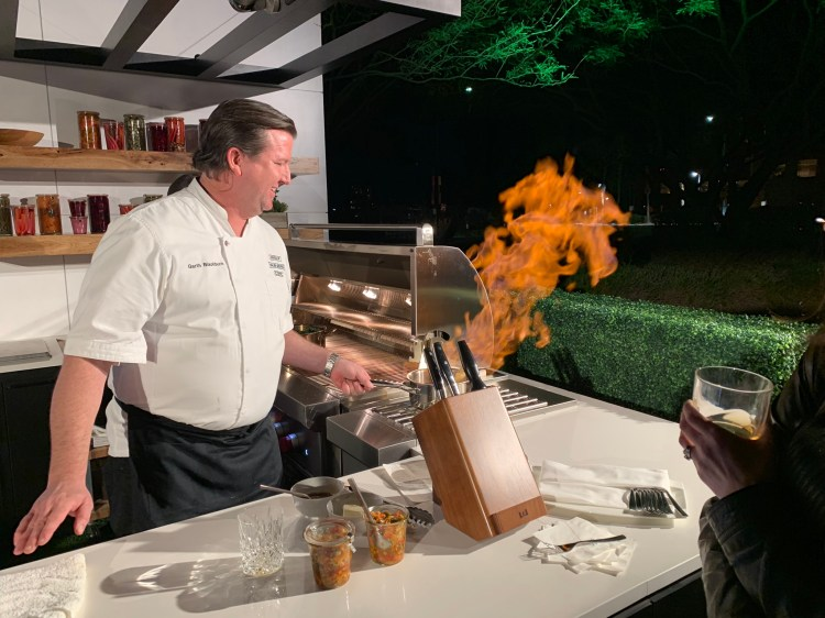 chef cooking on wolf outdoor luxury appliances