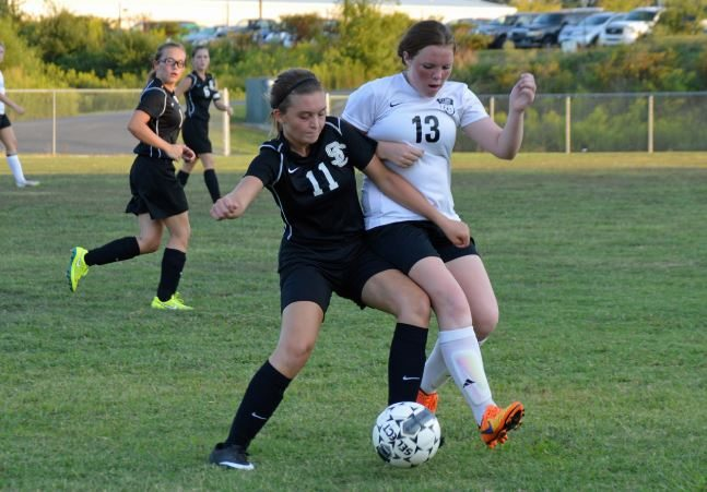 Alyssa Willams works to take control of the ball