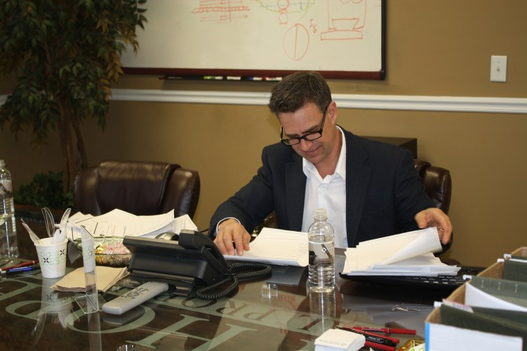 Anton Hopen reviewing documents