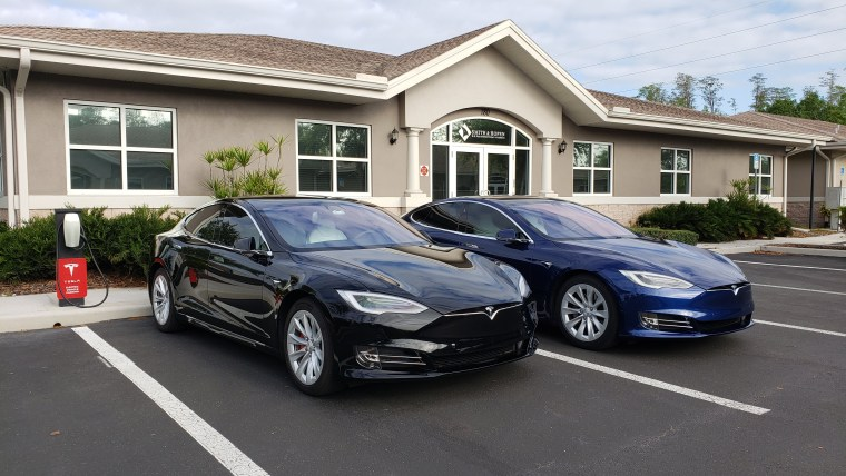 Tesla vehicles charging at Smith & Hopen office