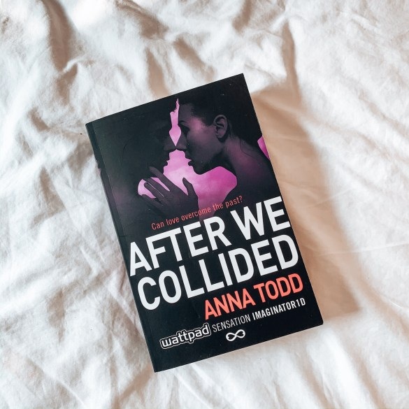 Book on white crinkled background. Cover of book is a man and woman nearly kissing and the words After We Collided underneath
