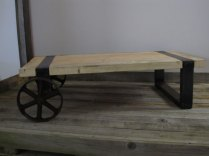 Vintage trolley wheels made into low coffee table with pine top and steel band legs £150