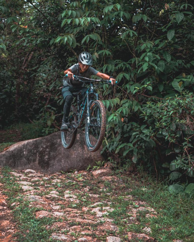 Image of mountain biker jumping