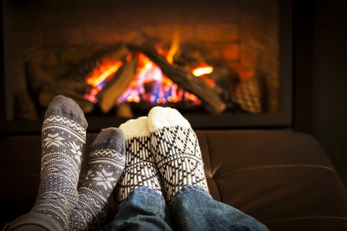 A gas fireplace can make your home cozier without the mess associated with wood-burning models.