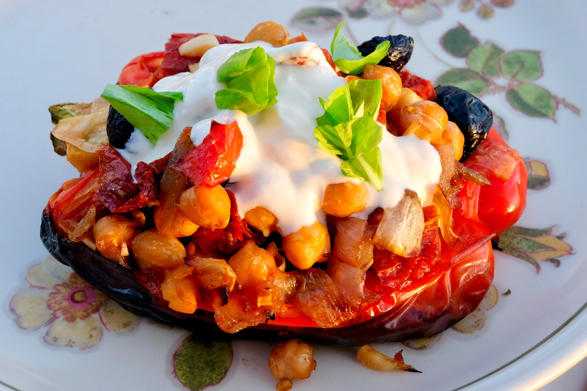 Grilled Peppers with chickpeas, tomatoes black olives and hot spicy yoghurt