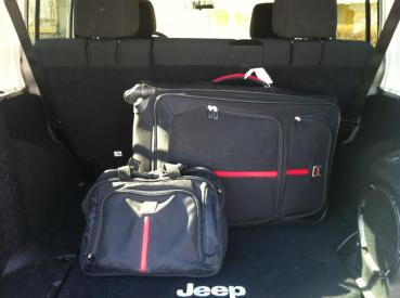 The cargo area swallowed our luggage.