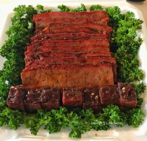 Brisket sitting on a bed of lettuce barbecue competition turn in box