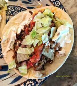 single portion of brisket tacos