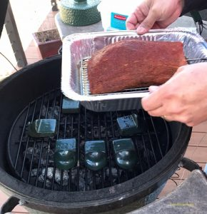 Placing the roast beef on the smoker