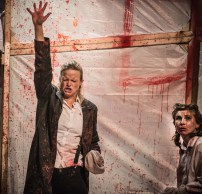 Titus (Henri Merriam) entreats the gods to help him avenge his mutilated daughter Lavinia (Leila Sykes) in Act 4 scene 1 of 'Titus Andronicus: an all-female production' by Smooth Faced Gentlemen, at The Bedlam Theatre, Edinburgh Fringe (photo: Daniel Harris)