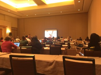 A seminar in a hotel conference room.