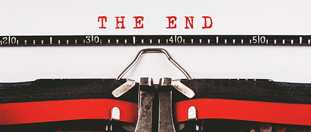 Typewriter with the words The End written in red ink