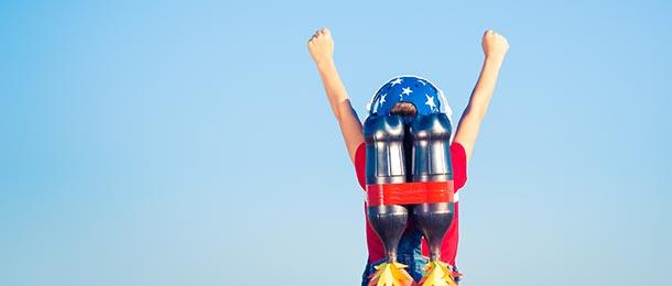Child wearing rocket backpack