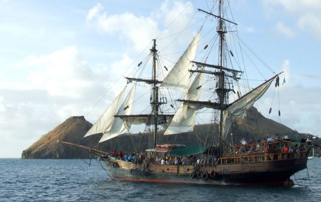 pirate ship anchored at island