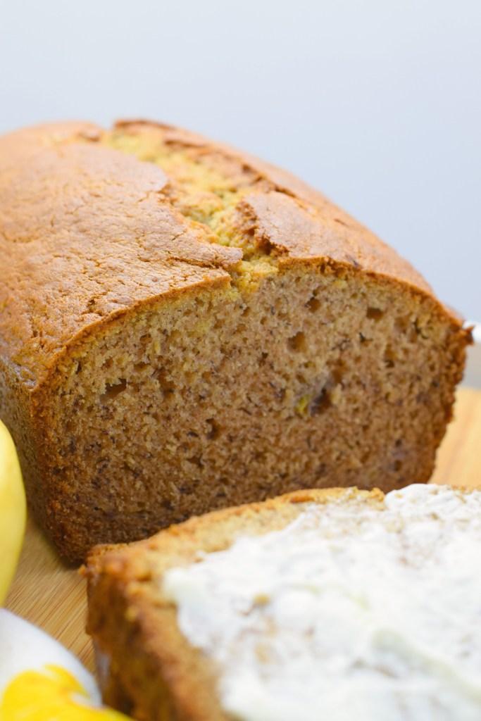 loaf of banana bread on wood board