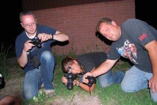 Jamison, Marisa and Shaun take photos of a Coral Snake