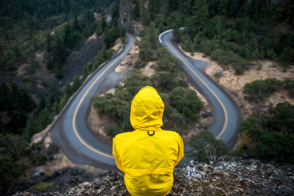 yellow, jacket, rain coat, people, rural, winding, road, hairpin, countryside, cliff, nature, trees