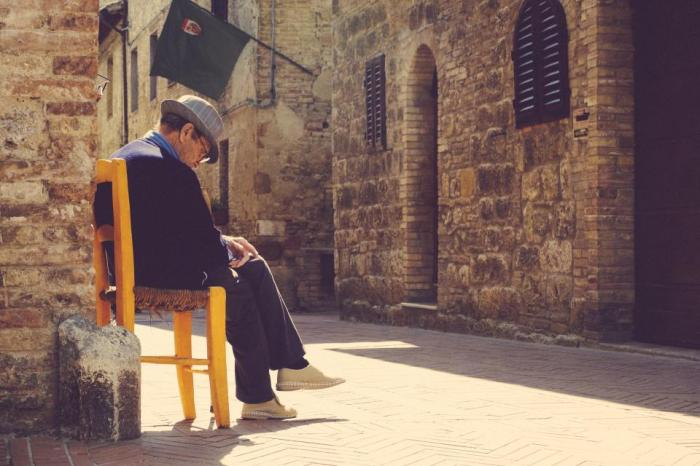 old, man, fedora, sitting, chair, street, cobblestone, stones, city, town, people, lifestyle