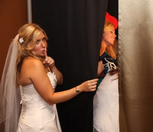 Bride sneaking into a snapfuze photo booth