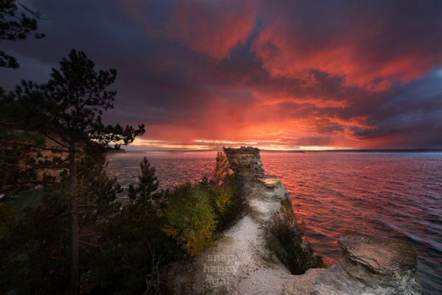 A dramatic sunset unfolds above Lake Superior at Miners Castle, Pictured Rocks