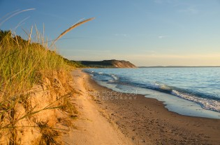 Photo: Warm dune grass frames a Lake Michigan beach
