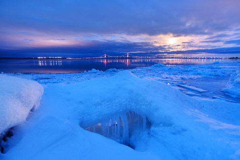 Photo: ice formations and Mackinac Bridge + reflections during moonrise