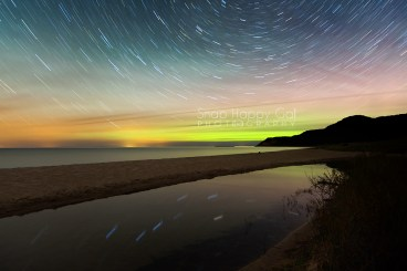 Photo: star trails and northern lights from a Lake Michigan beach