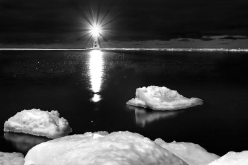 Photo: A black and white capture of a quiet winter night at northern Michigan's Frankfort Lighthouse