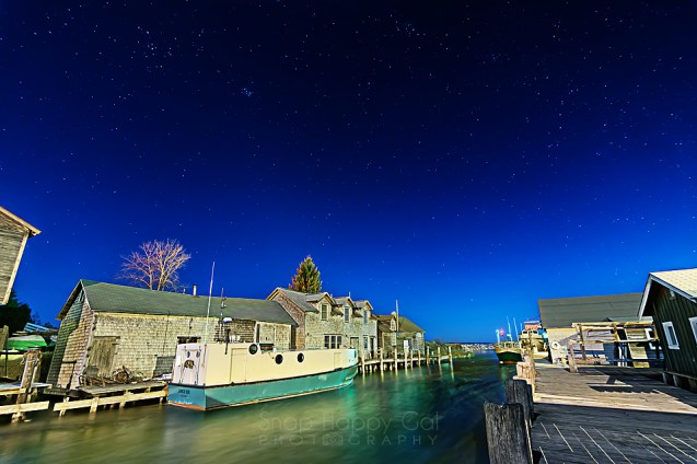 Photo: Fishtown/Leland, Michigan under a moonlit, starry night